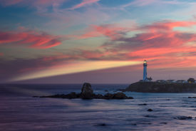 stock photo of pigeon  - Lighthouse at sunset - JPG