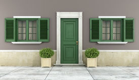 stock photo of windows doors  - Detail of a classic house with green wooden windows and front door  - JPG