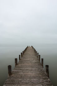 picture of jetties  - Deserted jetty pier in foggy weather vertical shot - JPG