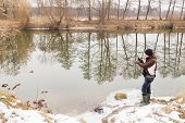 picture of fishermen  - Fisherman on the river bank - JPG