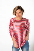 stock photo of pubic  - Athletic blonde in a red striped sweater - JPG