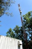 stock photo of mast  - High mast metal structure telecommunication on tower with blue sky - JPG