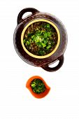foto of buckwheat  - Buckwheat porridge in the pot butter and chives and dill on a cutting board - JPG