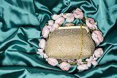 pic of clutch  - gold clutch in flowers on green silk - JPG