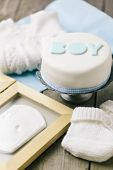 picture of memento  - Celebration cake for a baby boy with baby mementos
