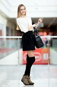 picture of short skirt  - Slender young woman in cute trendy outfit for shopping office or study - JPG