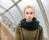 pic of dreadlocks  - Outdoors city portrait of young blonde hipster woman with dreadlocks in scarf and military style olive parka - JPG