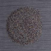 foto of opiate  - Top view of poppy seeds against grey vinyl background - JPG
