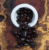 stock photo of mesquite  - Dark Roasted Coffee Beans on a mesquite board.