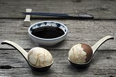 image of chinese parsley  - Two traditional Chinese tea eggs served on crackle glaze ceramic spoons  - JPG