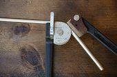 picture of bender  - Tube bender or pipe bender tools on wooden background - JPG