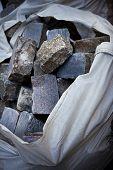 foto of cobblestone  - Bag of cobblestones on a construction site - JPG