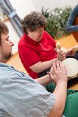 picture of disability  - a music therapy with a mentally disabled woman - JPG