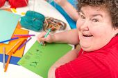 stock photo of disability  - a Ergotherapy with a mentally disabled woman - JPG