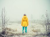 image of swag  - Young Woman standing alone outdoor Travel Lifestyle and melancholy emotions concept winter foggy nature on background film effects colors - JPG