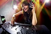 pic of mixer  - caucasian female dj using a mixer and computer to play mp3s - JPG
