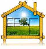 stock photo of tree house  - Wooden yellow meter ruler in the shape of house with country landscape with tree inside - JPG