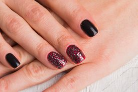 stock photo of nail paint  - . Beautiful female hands with nails painted nails. Art manicure. Art manicure. Creative manicure. Taking Close-up nails. Art nails. Nails art. Art manicured fingers. - JPG