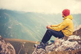 picture of boy scout  - Man Traveler relaxing alone in Mountains Travel Lifestyle concept cloudy nature landscape on background - JPG