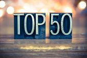 stock photo of 50s  - The word TOP 50 written in vintage metal letterpress type on a soft backlit background - JPG