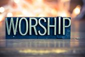 picture of worship  - The word WORSHIP written in vintage metal letterpress type on a soft backlit background - JPG