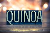 stock photo of quinoa  - The word QUINOA written in vintage metal letterpress type on a soft backlit background - JPG