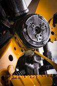 foto of machinery  - Gear machinery part robot on white background - JPG