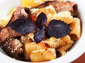 foto of veal  - Macaroni with veal casserole shot from above - JPG