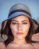 stock photo of arabic woman  - Closeup portrait of beautiful arabic woman wearing stylish sun hat - JPG