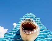 stock photo of great white shark  - A great white shark mounted on a blue wall - JPG