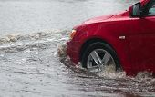 pic of rain  - car rides in heavy rain on a flooded road - JPG