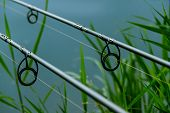 foto of rod  - twin fishing rods on a beautiful lake  - JPG