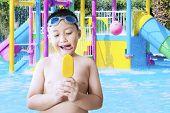 image of naked children  - Naked male kid wearing swimming glasses and enjoying ice cream at pool - JPG