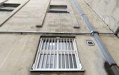 foto of prison uniform  - Prison walls surrounds walking yard in prison - JPG