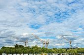 image of construction crane  - Crane construction in the city under the blue sky new building in Bangkok Thailand under construction - JPG