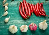 foto of red hot chilli peppers  - Red hot chili peppers with spice ingredients over wooden background - JPG