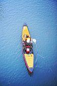 stock photo of kayak  - a kayaker in a kayak or canoe paddling down a river  - JPG