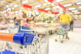 stock photo of grocery cart  - Blurred defocused grocery supermarket  - JPG
