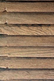 stock photo of abrasion  - Texture of brown yellow wooden abrasion wall - JPG