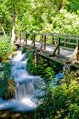 Waterfall under a bridge in Krka national park in Croatia