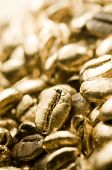 Macro image of gold coffee beans