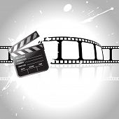 vector clapperboard with reel at back