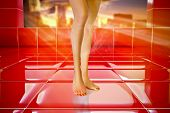 stock photo of floor heating  - A closeup on a plastic model legs stand on rich red floor tiles - JPG