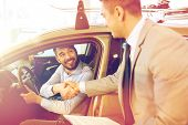 auto business, car sale, consumerism, gesture and people concept - happy man with car dealer making  poster