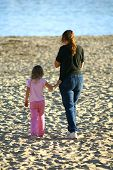 Mother And Daughter On The Beach In California
