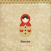Vintage matrioshka card with polka dots background