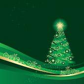 Glowing Christmas tree in a golden green winter garden