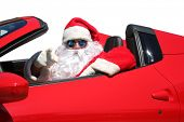 Santa Claus. Santa Points at You the Viewer as he drives his Red Hot Rod Sports Car. poster