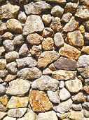 Abstract Background Made With Rock. Closeup View Of Rock Wall. Rock Wall Texture And Background For  poster