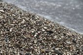 Pebble beach washed by the sea
